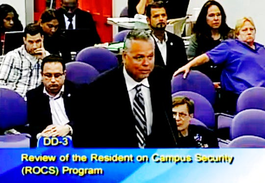 In this Feb. 18, 2015, file frame from video from Broward County Public Schools, school resource officer Scot Peterson talks during a school board meeting of Broward County, Fla.