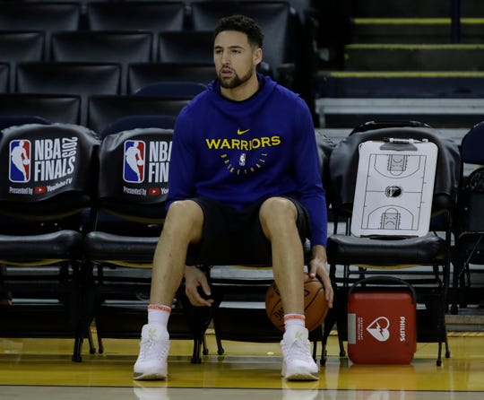Golden State's Klay Thompson sits on the bench during Tuesday's practice.