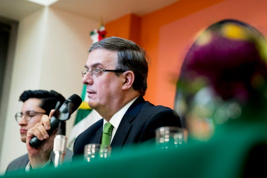 Mexican Foreign Affairs Secretary Marcelo Ebrard, right, speaks at a news conference at the Mexican Embassy in Washington, Tuesday, June 4, 2019, as part of a Mexican delegation in Washington for talks following trade tariff threats from the Trump Administration.