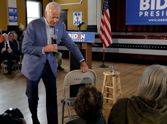 Former vice president and Democratic presidential candidate Joe Biden brings a chair over for a woman in the audience during a campaign event, Tuesday, June 4, 2019, in Berlin, N.H.