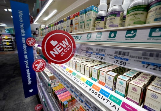 In this Thursday, May 30, 2019 photo, signs advertise new products available inside a CVS store with the new HealthHUB in Spring, Texas.