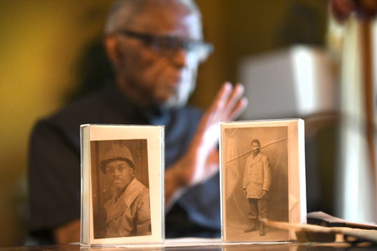 J. Bernard Taylor displays photographs from his Army service in World War II in his Westland home.