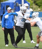 Lions tight end Michael Roberts (left) had just nine catches in eight games last season.
