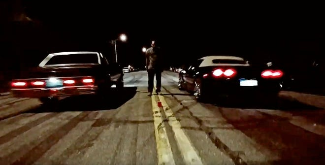 A Malibu and a Corvette face off in a drag race on a Detroit street in 2018. Police officials have started to deploy helicopters to curb illegal racing and off-road vehicle use.