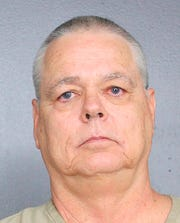 This undated photo provided by the Broward County, Fla., Sheriff's Office shows Scot Peterson, a former Florida deputy.