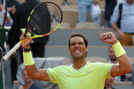 Spain's Rafael Nadal celebrates winning his quarterfinal match of the French Open tennis tournament against Japan's Kei Nishikori in three sets, 6-1, 6-1, 6-3, Tuesday at the Roland Garros stadium in Paris.