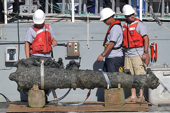 Researchers rest a recovered 2,000-pound cannon on the back of a NOAA research vessel from the wreck of the pirate Blackbeard's ship, which has been on the ocean floor off the North Carolina coast for nearly 300 years Oct. 26, 2011, in Beaufort, N.C.