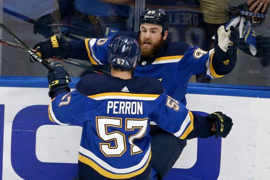 St. Louis Blues center Ryan O'Reilly (90) celebrates with David Perron (57) after O'Reilly scored his second goal of the game during the third period of Game 4 on Monday.