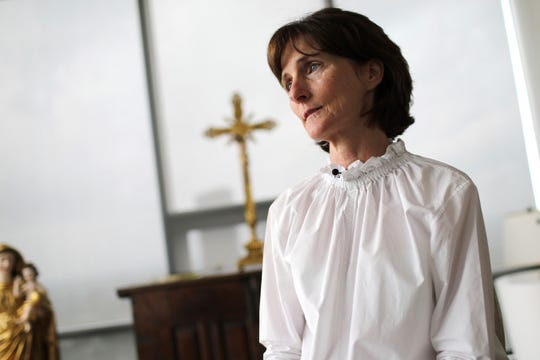 Laura Pontikes pauses during an interview in the prayer section of her apartment in Houston on April 13, 2019. The 55-year-old Texas construction company executive and mother of three had been seeking God when she began spiritual counselling with Monsignor Frank Rossi.