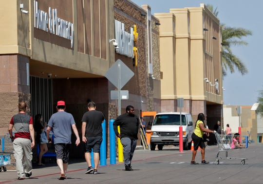 Shoppers enter and exit a Walmart in Tempe, Ariz. Executives at Walmart and dollar-store chains, which import much of their merchandise and serve many low-income customers, have warned that tariffs could lead to higher prices for consumers.