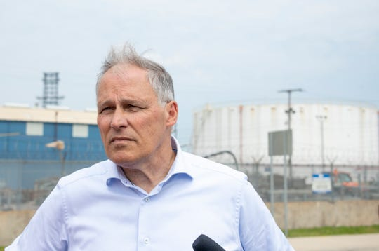 "Washington Governor and democratic presidential candidate Jay Inslee talks to the media while touring southwest Detroit near the Marathon refinery as part of his ""Climate Mission Tour""."