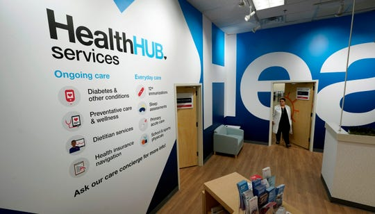 Family Nurse Practitioner Serena Lopez exits an exam room at the new HealthHUB inside a CVS store in Spring, Texas.