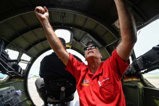 Flight engineer Paul Bienvenu with the Commemorative Air Force Texas Raiders B-17 shows how to remove the navigators dome in case of an emergency during a pre-fight check in the historic war bird Monday, June 3, 2019.