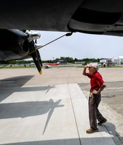 WWll veteran and P-47 pilot Allen Sanderson looks over the Commemorative Air Force Texas Raiders B-17 before taking a flight in the historic war bird Monday, June 3, 2019.