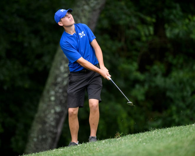Memorial's Matthew Godsey hits onto the ninth-hole green during the sectional at Helfrich Hills on May 30, 2019.