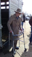 Barney Barnhart still works as an auctioneer as he sells feeder pigs for the Hillsdale Auction. He is 98 years old and has been an active auctioneer for over 50 years.