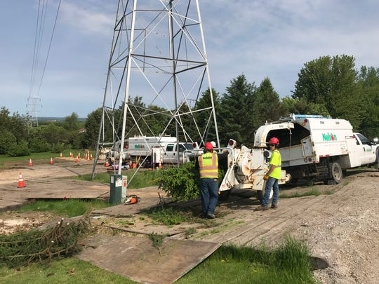A crew from Nelson Tree Service clear cuts 31 trees on the Roger and Linda Sarauer property Monday. American Transmission Company is replacing high-voltage wires and old towers that date back to 1928.