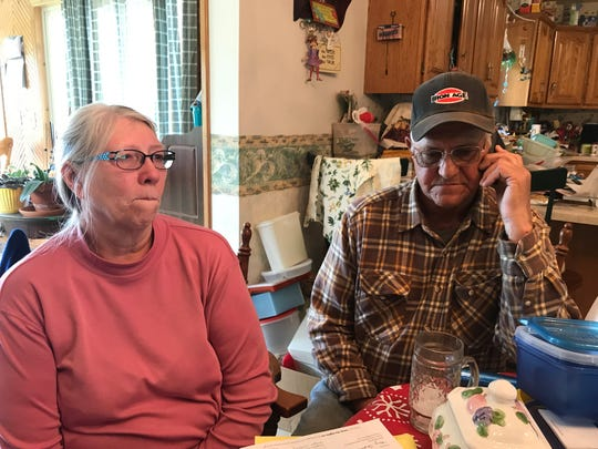 Linda and Roger Sarauer talk on the phone to their attorney as 31 trees are clear cut from their property Monday. The couple tried to stop American Transmission Company from removing the trees on their town of Empire property, but lost the battle.