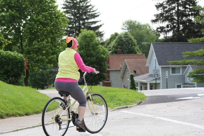 A woman takes advantage of cooler temperatures Tuesday to enjoy a bicycle ride.