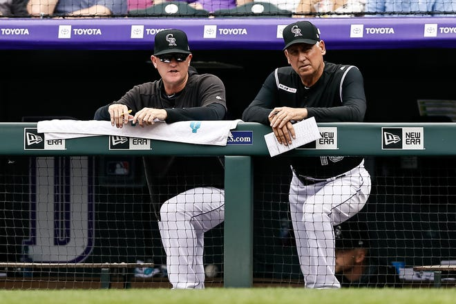 Colorado Rockies pitching coach Steve Foster and manager Bud Black watch from the dugout during a home game Sunday against the Toronto Blue Jays in Denver. The Rockies play road games at 6:05 p.m. Wednesday and 12:20 p.m. Thursday against the Cubs in Chicago.