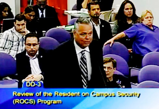 In this Feb. 18, 2015, file frame from video from Broward County Public Schools, school resource officer Scot Peterson talks during a school board meeting of Broward County, Fla. Peterson, the then-Florida sheriff's deputy assigned to protect the high school where 17 died in a 2018 shooting has been arrested on 11 charges, Tuesday, June 4, 2019. State Attorney Mike Satz announced that 56-year-old Peterson faces child neglect, culpable negligence and perjury charges.