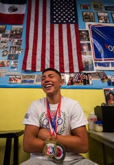 Danilo Diez, 16, of Cape Coral, shares a laugh while attending a visit from boxer Tiara Brown to Fort Myers. Tiara Brown returned to speak to the Fort Myers PAL Boxing Academy on Monday, June 3, 2019 after winning an IBF Intercontinental championship on May 19. 