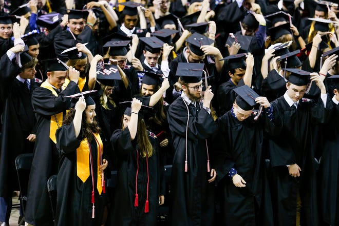Students move their tassels after the De Pere High School graduation ceremony at the Kress Events Center on June 3, 2019 in Green Bay, Wis.