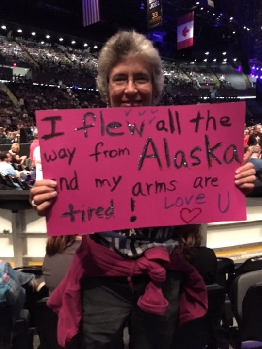 Sturgeon Bay native Gretchen Hennessy is flying from Alaska to see Paul McCartney at Lambeau Field, and she's taking her 88-year-old dad, Joe Fischer, with her. He was the inspiration for this sign she took to a previous McCartney concert in New York.