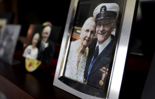 Photos of World War II veteran Bob Reeners with  Dot, his wife of 70 years, are displayed in their Oneida home.