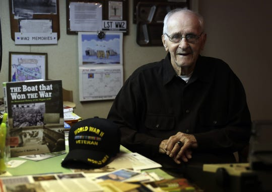 World War II veteran Bob Reeners, who participated in the D-Day assault on the northern coast of France, is surrounded by mementos from his time in the military at his home in Oneida.