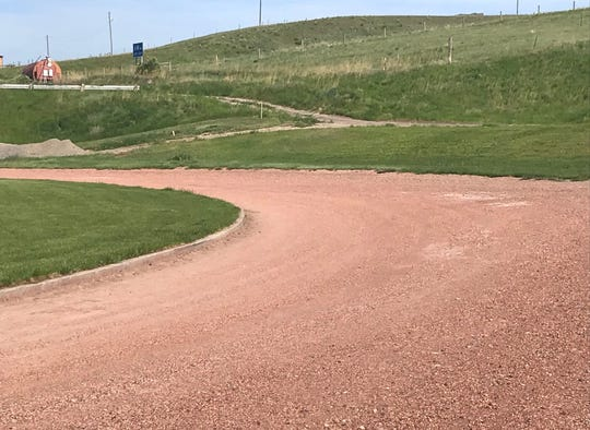 A portion of the infield on the north end of Badger Stadium will be removed so the track can be reduced from 440 yards in length to 400 meters to conform to National High School Federation and Montana High School Association standard.