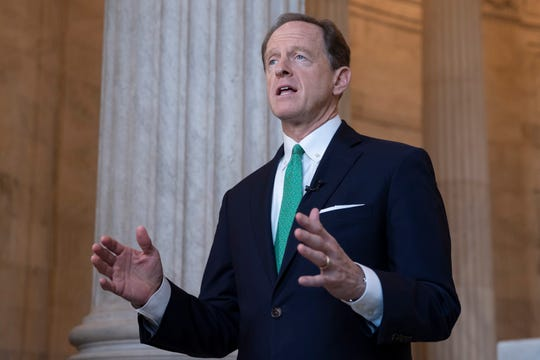 Sen. Pat Toomey, R-Pa., speaks during a 2018 interview in Washington.