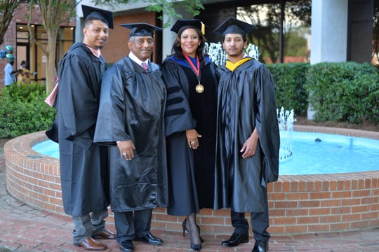 The McCon family poses for a photo before graduation May 16 at William Carey's Hattiesburg campus. From left, son Reubon Perez McCon, father Reubon Fitzgerald McCon, wife Angela Jupiter-McCon and son Neuman McCon.