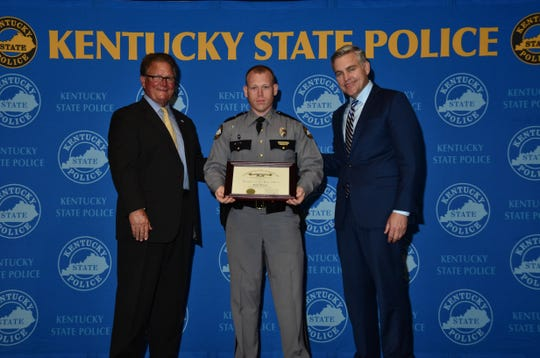 (From left to right) Commissioner Rick Sanders, Trooper Blake Owens and Justice Secretary John Tilley.