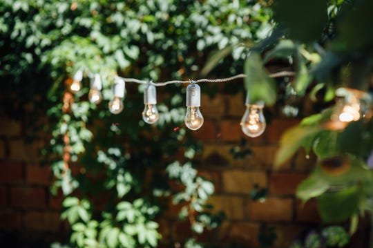 Stringing lights adds a festive air to outdoor parties.