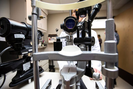 A piece of equipment used for an eye exam is shown in this file photo from May 31, 2019. A new report suggests that nearly 40 percent of Americans have myopia, up 25 percent from just 40 years ago, according to the American Optometric Association.