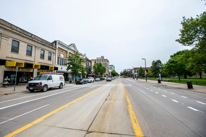 New paint markings line the road, Monday, June 3, 2019, along Clinton Street, between Washington Street and Iowa Avenue in downtown Iowa City.