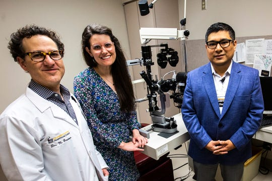 Drs. Mark Greiner, from left, Brittni Scruggs and Jorge Salinas pose for a photo, Friday, May 31, 2019, at the University of Iowa Hosptials and Clinics in Iowa City.
