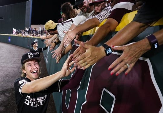 Mississippi State sophomore left fielder Rowdey Jordan celebrates with fans after winning the Starkville Regional. The Bulldogs host Stanford this weekend in the Starkville Super Regional.