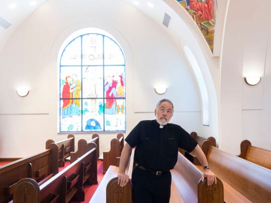 The Rev. Anthony Stratis looks up to the dome at St. George Greek Orthodox Church on Tuesday, June 4, 2019.