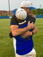 Frankfort baseball coach Andy Dudley embraces senior third baseman Jose Valdes Sandoval after the Hot Dogs fell 2-1 to second-ranked Edgewood in the Class 3A regional at Crawfordsville.