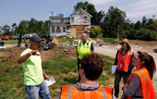 Dave Winland, left, talks to members of a tornado damage assessment team from Hocking County Emergency Management Agency Monday, June 3, 2019, near Laurelville. An EF2 tornado that touched down near Laurelville damaged a number of homes in the area. Three damage assessment teams went out to talk to residents in the effected area Monday.