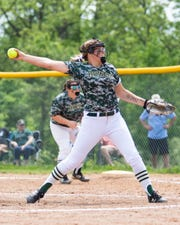 Howell's Molly Carney threw a perfect game and two-hitter in district victories over Dexter and Ann Arbor Skyline.