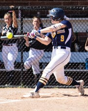 Hartland's Brooke Cowan hits a grand slam in a nine-run first inning that propelled the Eagles to a 12-2 victory over Milford in the district championship game on Monday, June 3, 2019.
