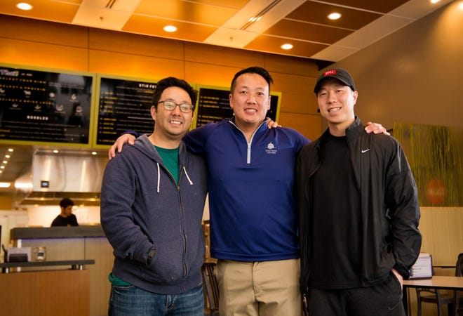 College buddies and co-owners of several No Thai! restaurants Jeffery Cho, Noerung Hang and Brian Kim are gearing up to open their sixth location in Brighton. They are pictured in one of their Ann Arbor locations, on S. Main Street in the city.