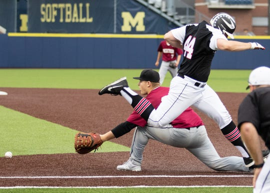 Pinckney's Will Schultz beats out a throw to first base against Dexter in a district championship baseball game at the University of Michigan.