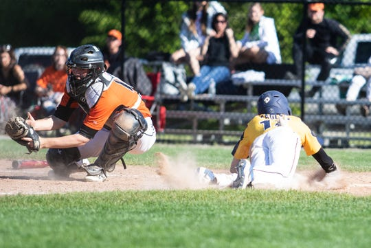 Hartland's Brett Tome slides home with a run in a 6-5 loss to Fenton in a district baseball championship game on Monday, June 3, 2019.