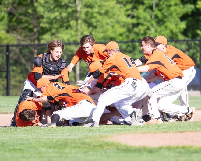 Fenton celebrates after scoring the winning run in a 6-5 victory over Hartland in a district baseball championship game on Monday, June 3, 2019.