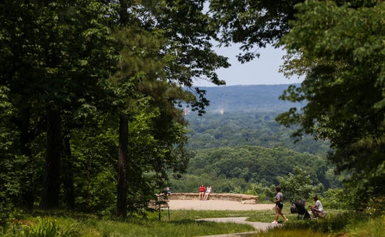 The view from the top of the Scenic North Overlook at Iroquois Park is about a mile and half walk (shorter if you take one of a few trail paths that carve through the hillside). Cars can drive to the top on Wednesday, Saturday and Sunday -- otherwise it's a walk or bike ride. June 4, 2019.