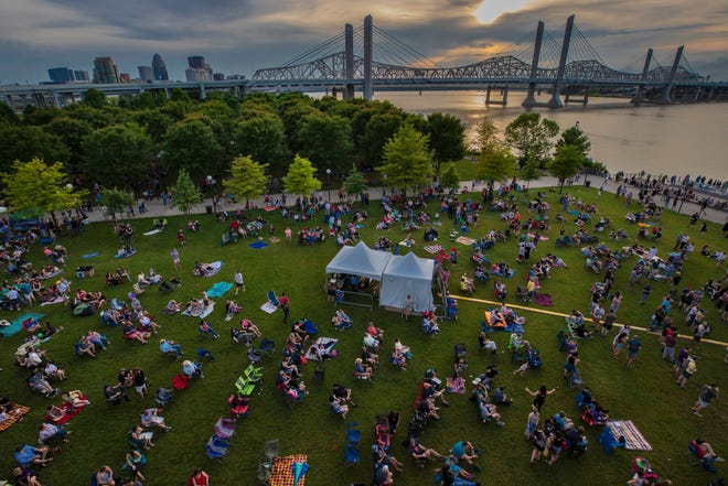 Spectators take seats in the grass during  the second Waterfront Wednesday of the year. May 29, 2019